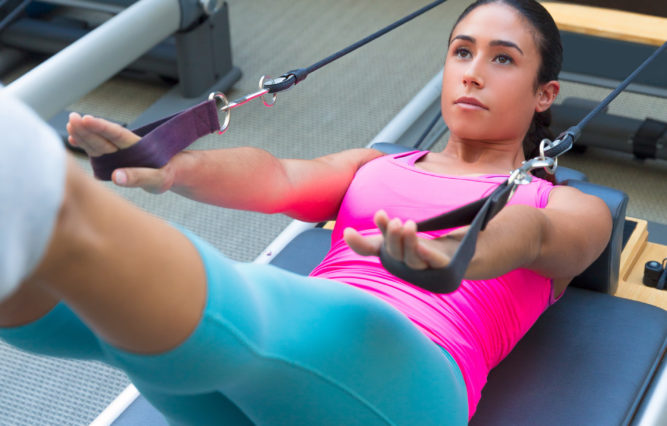 woman doing pilates at Aspen Club